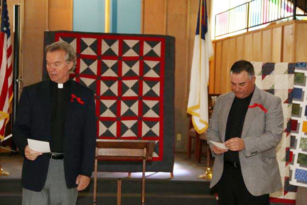 Pastor Charles Neugebauer and Chaplain Craig Muehler acknowledge CTK's veterans at a reception in their honor.
