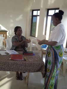 making a loan repayment. This system teaches the widows how to manage a business and repaying the loan keeps the program going. You can see the pride on her face.