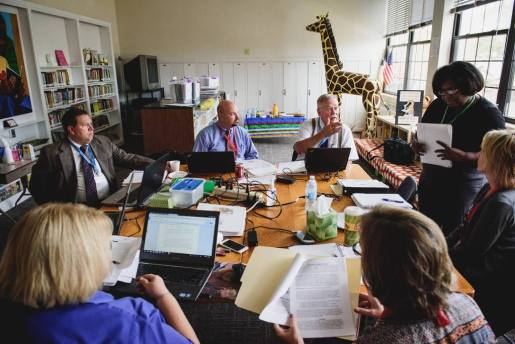 Terry Schmidt (back right), director of LCMS School Ministry, leads the NLSA team assigned to River Roads Lutheran School, St. Louis, during an October 2016 visit.