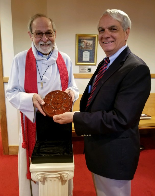 Pastor Hildebrandt present carving for 45 years ministry