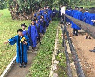2019 LIME Graduates walking to graduate