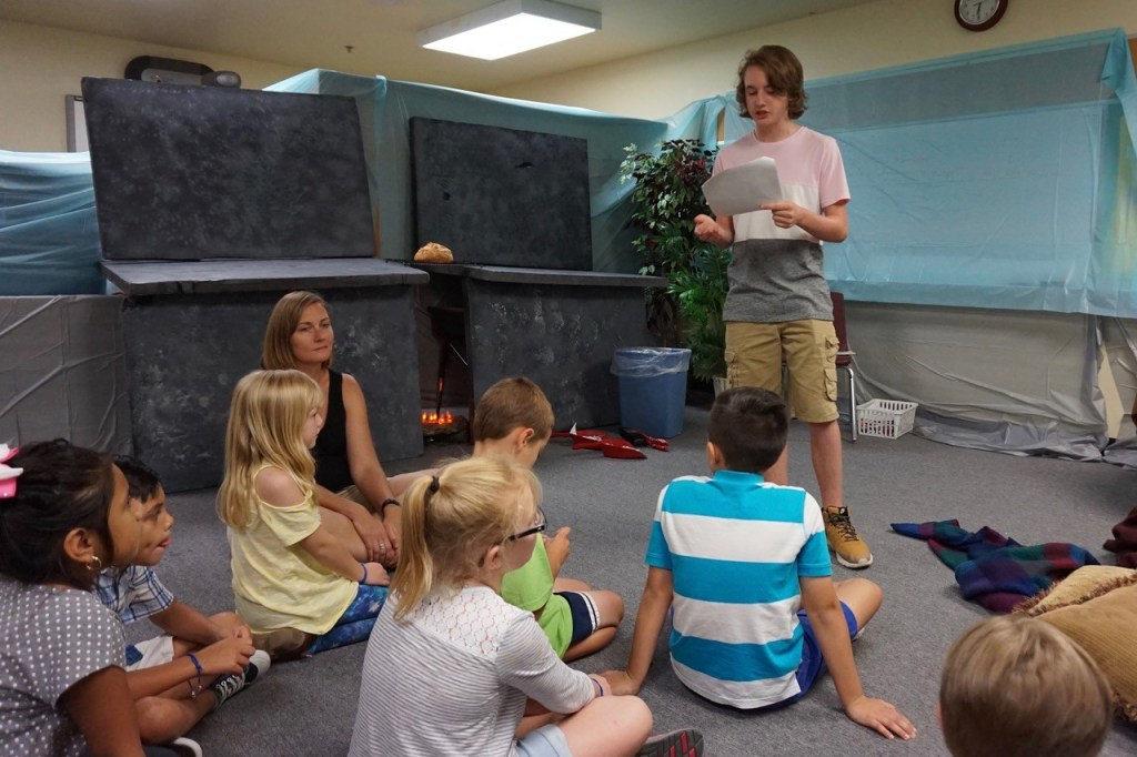 Levi teaches Bible stories at VBS