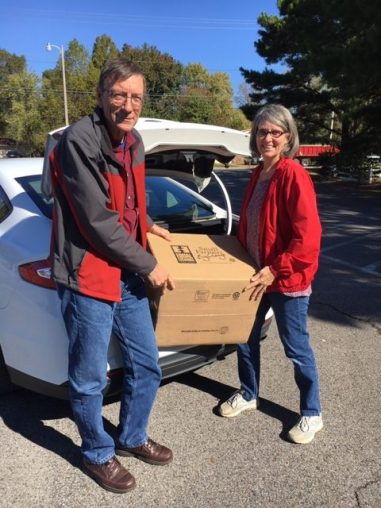 Pastor Russell and Nancy Shewmaker delivering boxes