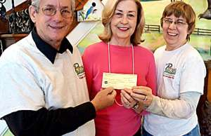 """Jim Scamodella and his wife Brenda from """"PAWS FOR SENIORS' receiving a check from ARF Vice-President Mary Johnson."""