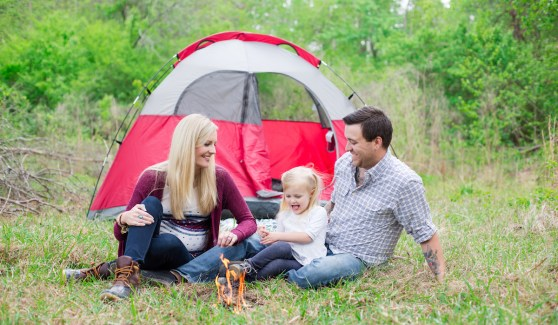 Family Photography - Family outside in the woods around campfire