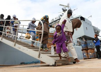 Migrants arrive at a naval base after they were rescued by Libyan coast guards in Tripoli , Libya/REUTERS