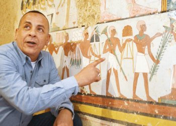 mustafa al wazier , director of luxor's antiquities,points at an ancient Egyption found at a newly discovered tomb in luxor /AFP