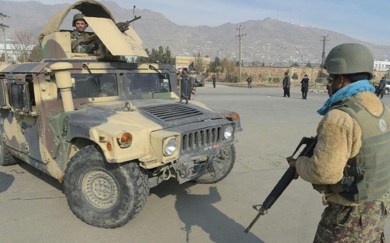 Afghan troops arrive at the scene in Kabul, where the resurgent Taliban and increasingly IS have both stepped up their attacks, targeting security installations and mosques SHAH MARAI (AFP)