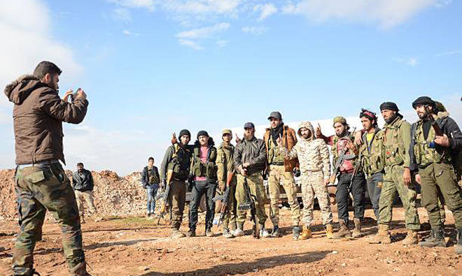 Fighters from the Free Syrian Army pose for a photo near the town of Qabasin,northeast of Al-Bab, some 30km from Aleppo/AFP