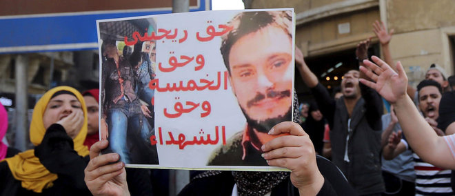 Giulio Regeni seen here on a posted held by an Egyptian activist/REUTERS