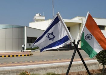 The national flags of Israel and India stand in the campus of the Center of Excellence for Vegetable at Vadrad village, some 70 km from Ahmedabad, on january 12,2018/AFP