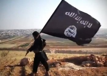 A man waves a Daesh flag in this file photo AFP