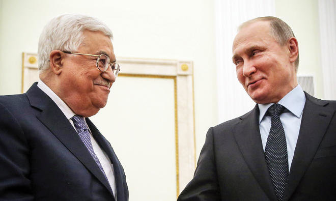 Russia President Valdmir Putin, Right, shake hands with Palestinian President Mahmoud Abbas during their meeting in Kremlin in Moscow on Monday AFP