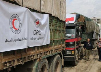 An aid convoy from the International Committee of the Red Cross arrives in Syria's northern region of Afrin on March 1, 2018 for the first time since Turkish-led fighters launched an assault on the Kurdish enclave in January. (AFP / Ahmad Shafie Bilal)