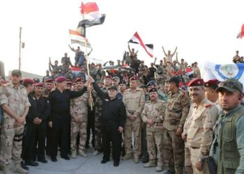 Iraqi Prime Minister Haider Abadi is fighting for his political career even as he rides a wave of popular support thanks to his victories on the battlefield. (FIle/Reuters)