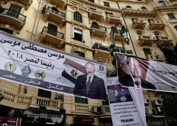 In this March 1, 2018 file photo, Election campaign posters for Egyptian presidential candidates Moussa Mustafa Moussa, left, and Egyptian President Abdel-Fattah El-Sisi, right, are displayed in downtown Cairo, Egypt. (AP/Nariman El-Mofty, File)