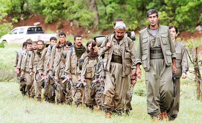 In this May 14, 2013 file photo, a group of armed Kurdish fighters from the Kurdistan Workers Party (PKK) enter northern Iraq in the Heror area, northeast of Dahuk, 260 miles northwest of Baghdad, Iraq. (AP)