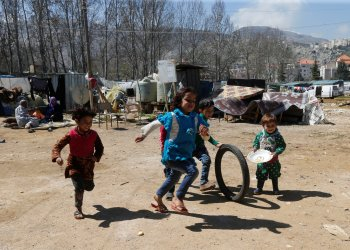 Syrian refugee children run in a tented settlement, in the town of Qab Elias, in Lebanon's Bekaa Valley, March 13, 2018. Picture taken March 13, 2018. REUTERS/Mohamed Azakir