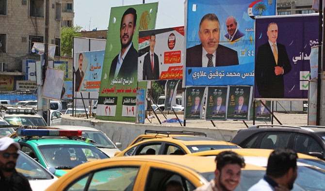 Campaign posters for candidates in the upcoming Iraqi parliamentary elections are seen in Baghdad on April 19, 2018. (AFP / AHMAD AL-RUBAYE)