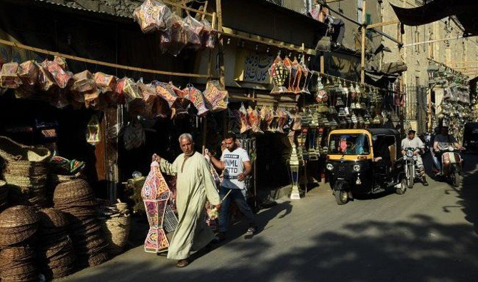 "Egyptians shop for traditional lanterns known in Arabic as ""Fanous"" sold during Ramadan in Cairo's Saida Zeinab district on May 24, 2017, ahead of the start of the Muslim holy fasting month of Ramadan. (AFP)"