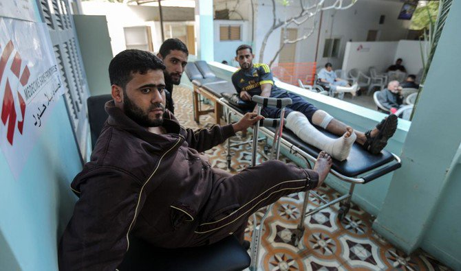 "Palestinians, wounded in previous weeks during mass protests against Israeli forces along the border of the Palestinian enclave, dubbed ""The Great March of Return,"" await medical check-up at the Doctors Without Borders (MSF) clinic in Gaza City on April 25, 2018. (AFP)"