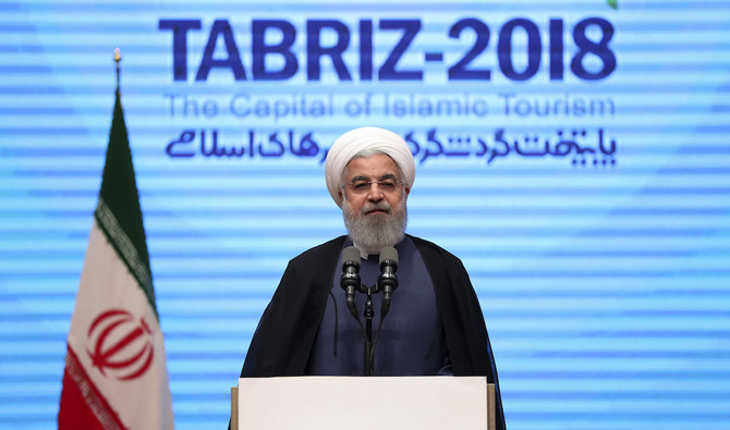 In this photo released by official website of the office of the Iranian Presidency, President Hassan Rouhani speaks during a conference in the northwestern city of Tabriz, Iran, Wednesday, April 25, 2018. (Iranian Presidency Office via AP)