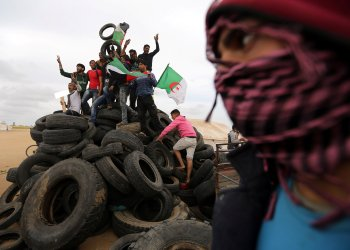 Palestinian activists collect tyres to be burnt along Israel-Gaza border, in the southern Gaza Strip April 3, 2018. REUTERS/Ibraheem Abu Mustafa