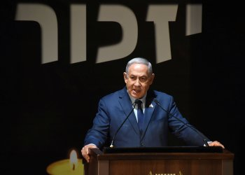 FILE PHOTO - Israeli Prime Minister Benjamin Netanyahu speaks during a Memorial Day ceremony at Mount Herzl military cemetery in Jerusalem, April 18, 2018. Debbie Hill/Pool via Reuters
