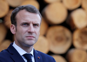 French President Emmanuel Macron visits the Germain-Mougenot sawmill during a day-trip about the wood industry in Saulxures-sur-Moselotte, France, April 18, 2018. REUTERS/Vincent Kessler/Pool/File Photo