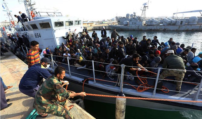 IIIegal migrants of different African nationalities arrive at a naval base in the capital Tripoli on April 22, 2-18 after they were rescued off the coast of Zlitan from two inflatable boats /AFP/ Mahmud Turkia