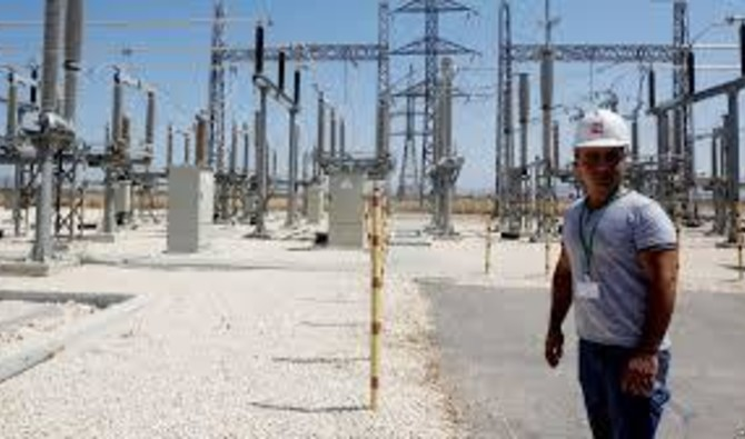 File photo showing an Israeli engineer at an electrical substation near the West Bank city of Jenin, July, 2017. (Reuters)