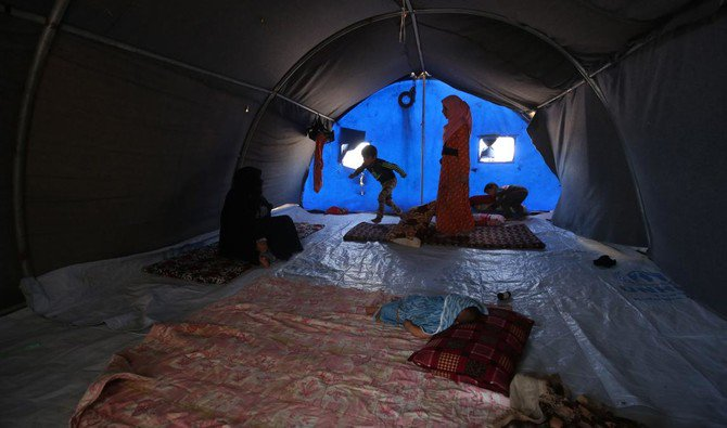 """Displaced Iraqis are seen in a tent where they are taking shelter in """"Camp Seven"""" near Al-Khalidiyeh in Iraq's western Anbar province on April 24, 2018. (AFP/ Ahmad Al-Rubaye)"""