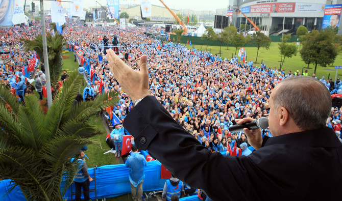 "This handout picture taken and released on May 6, 2018 by the Turkish Presidential Press office shows Turkish President Recep Tayyip Erdogan addressing his supporters during a rally in Istanbul on May 6, 2018. Turkey will hold parliamentary and presidential elections on June 24, 2018, seen as important as it will transform Turkey's governing system to an executive presidency which expands the head of state's powers. Four Turkish opposition parties announced they had formed a coalition to challenge President Recep Tayyip Erdogan in snap elections on June 24. - RESTRICTED TO EDITORIAL USE - MANDATORY CREDIT ""AFP PHOTO / TURKISH PRESIDENTIAL PRESS SERVICE / MURAT CETIN MUHURDAR - NO MARKETING NO ADVERTISING CAMPAIGNS - DISTRIBUTED AS A SERVICE TO CLIENTS / AFP / TURKISH PRESIDENTIAL PRESS SERVICE / Murat CETIN MUHURDAR / RESTRICTED TO EDITORIAL USE - MANDATORY CREDIT ""AFP PHOTO / TURKISH PRESIDENTIAL PRESS SERVICE / MURAT CETIN MUHURDAR - NO MARKETING NO ADVERTISING CAMPAIGNS - DISTRIBUTED AS A SERVICE TO CLIENTS"