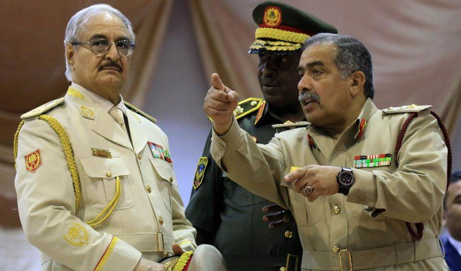 """Photo showing Libyan Strongman Khalifa Haftar attends a military parade in the eastern city of Bengahzi on May 7, 2018, during which he announced a military offensive to take from """"terrorists"""" the city of Derna, eastern Libya. (AFP)"""