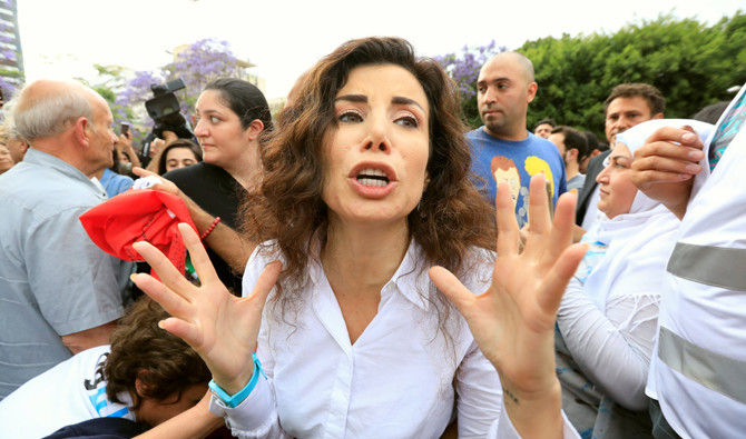Independent parliamentary candidate Joumana Haddad reacts during a protest in Beirut, Lebanon May 7, 2018. REUTERS/Jamal Saidi