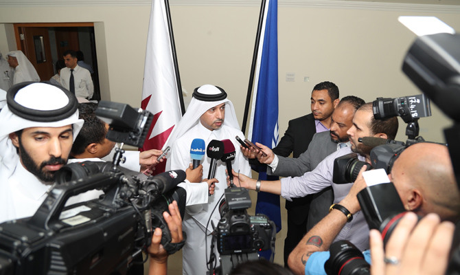 Issa Saad Al-Jafali Al-Nuaimi (C), Qatar's Minister of Administrative Development, Labour, and Social Affairs, speaks to the press during the inauguration of the International Labour Organisation (ILO)'s Qatar project office, in the capital Doha on April 29, 2018. / AFP / STR