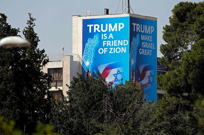 A poster praising US President Donald Trump covers a section of the Diplomat Hotel, adjacent to the US consulate in Jerusalem which will host the new US embassy. The United States is moving its embassy in Israel to Jerusalem next week in defiance of the Palestinians and most of the world. (AFP)