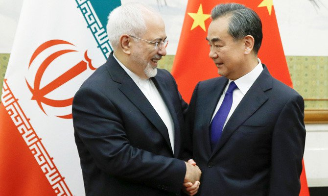 Chinese Foreign Minister Wang Yi meets his Iranian counterpart Javad Zarif at Diaoyutai state guesthouse in Beijing on Sunday. (Reuters)