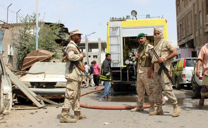 A picture taken on March 13, 2018 in the southern Yemeni city and government bastion of Aden shows government soldiers at the scene of an explosion from a suicide bombing claimed by the ISIS group which hit UAE-trained Yemeni troops. (AFP)