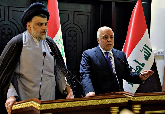 """Iraqi Prime Minister Haider al-Abadi, left, meets with Shiite cleric Muqtada Al-Sadr in Baghdad early Sunday. Al-Sadr, whose coalition won the largest number of seats in Iraq's parliamentary elections, says the next government will be """"inclusive."""" (Iraqi government via AP)"""