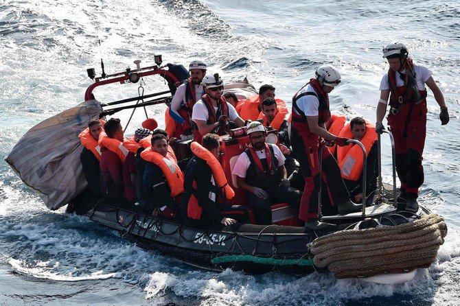 Photo showing a group of migrants transferred, off Libya coast on May 12, 2018. (AFP)