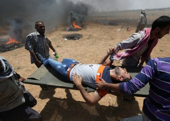 A wounded Palestinian is evacuated during a protest against U.S. embassy move to Jerusalem and ahead of the 70th anniversary of Nakba, at the Israel-Gaza border in the southern Gaza Strip. REUTERS/Ibraheem Abu Mustafa
