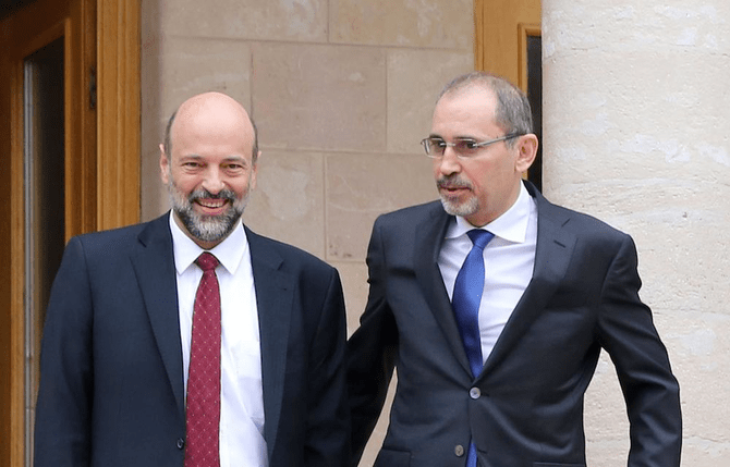 File photo showing Jordan's newly appointed PM, the ex-Education Minister Omar Al-Razzaz speaking with Foreign Minister Ayman Safadi in Amman. (AFP)