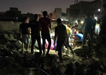 People look for for missing victims after explosions in Sadr City, Baghdad, Iraq, Wednesday, June 6, 2018. (AP)