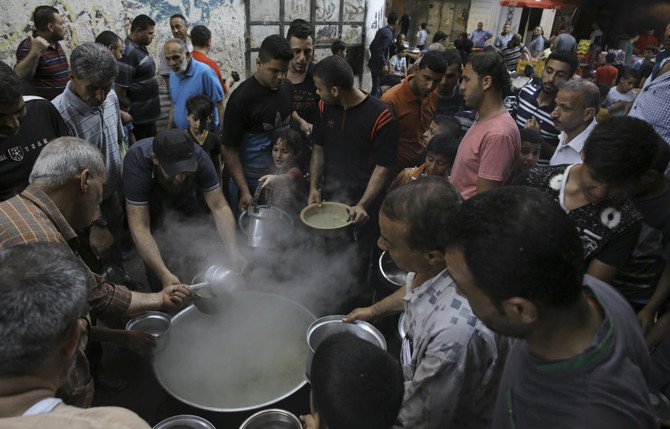 Free porridge is distributed to the poor during the holy fasting month of Ramadan in Gaza City. Growing despair in Gaza has helped drive recent Hamas-led protests against the border blockade by Israel and Egypt. (AP)