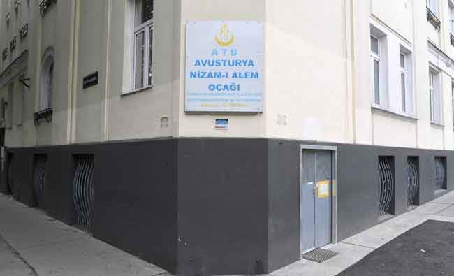 """Exterior view taken on June 8, 2018 shows the plaque of the """"Nizam-i Alem"""" mosque in Vienna that is part of seven mosques that the Austrian government announced they would shut down. (AFP)"""
