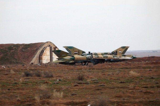 File photo showing two Assad regime Mig-21 fighter jet in an airfield in Syria. (AFP)