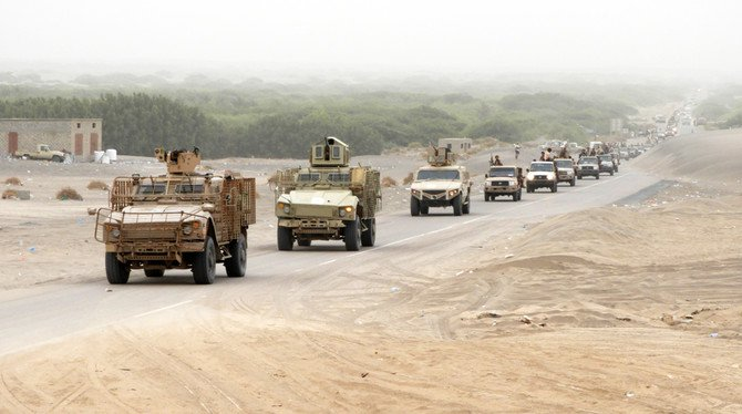 A column of Yemeni government forces armored vehicles arrives in al-Durayhimi district, about nine kilometers south of Hodeidah international airport on June 13, 2018. (AFP / NABIL HASSAN)