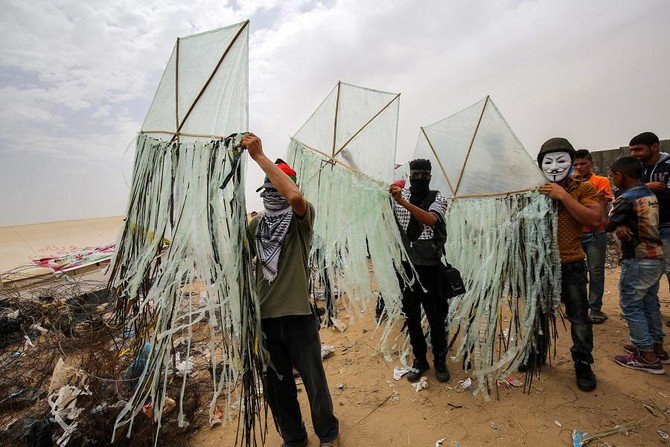 Palestinians prepare kites before trying to fly them with incendiaries over the border fence with Israel, in Khan Yunis in southern Gaza Strip on May 4, 2018 (Said Khatib/AFP)