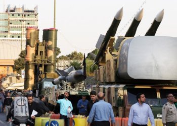 A Russian-made S-300 air defense system, left, is on display for the annual Defense Week, in Tehran, Iran. /(AP)